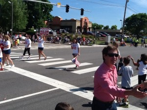 Knox County Circuit Court Judge Candidate Bill Ailor greets spectators as he volunteers cheer down the road.