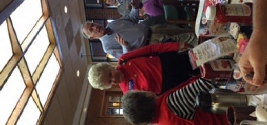 Sue Atchley standing talks with Libby Neff. Former County Commissioner Paul Pinkston is behind Atchley.