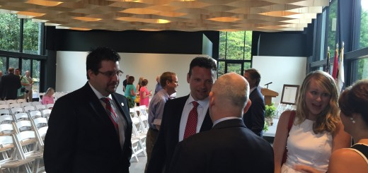 Senator Richard Briggs talking with State Rep. Eddie Smith and Jason Zachary