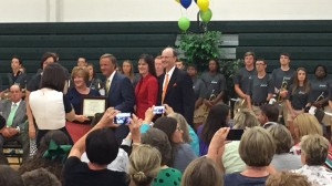 Stefanie Thompson, Principal at Farragut High School receiving reward school status for Farragut from TN Governor Bill Haslam, TN Commissioner of Education Candace McQueen and Dr. James P. McIntyre, Jr., Superintendent of Knox County Schools.