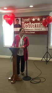Janet Testerman speaking to those attendees about the next 6 months and about dollars and doors. There is something for everyone, contribute dollars and/or knock on doors.