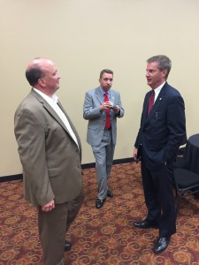 Anders talks with Mayor Burchett, while Knox County Finance Director Chris Caldwell stands off to the side sampling the exceptional food.