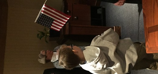 Trace Nystrom leads the Pledge of Allegiance at the West Knox Republican Club