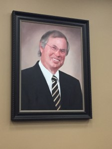 A portrait of Robert H. Watson, Jr. in the Courtroom named in Memory of the great man.