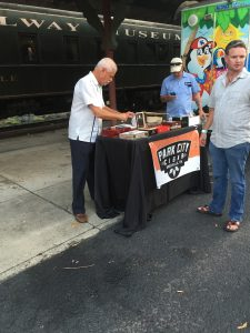 Knoxville Business Owner John Stancil of Park City Cigar was set up helping those who enjoy a smoke.