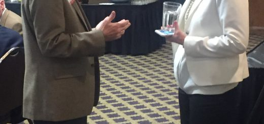 State Rep. Bill Dunn talking to Kristen Farley before the luncheon.