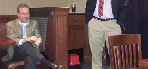 State Representative Roger Kane speaking and State Representative Martin Daniel listening.