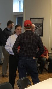 Spangler talking with attendees