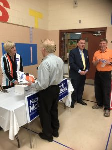 Nick and Lisa McBride talking with voters and attendees