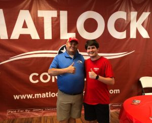 Drake Lyle, a dedicated Matlock worker and I in front of the Matlock wall.