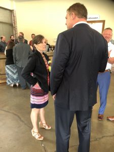 Jacobs talking with Ashley Nickloes, Candidate for TN Second Congressional District.