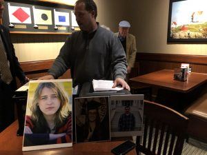 After his talk, Eimers with many of the documents he has discovered along with photos of Hannah and two other victims of the X-Lite Guardrails