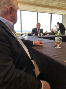 Mayor Jacobs engaged in discussion with three area businesses without handlers