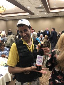 Dan Andrews was a door prize winner of a bottle of crushed grapes aka wine