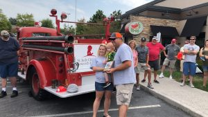Cooper, a patient at St. Judes gave an award for his pick, the fire truck owned by Leon Shields.