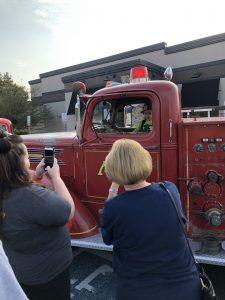Cooper, a patient of St. Jude's checks out the fire truck