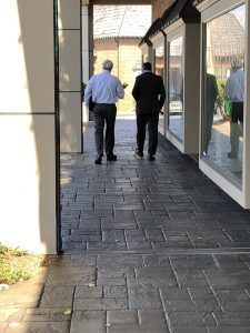 Schoonmaker and Jay walking to their cars