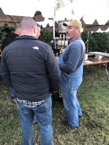 Darrell Miller of Bootleggers in Hartford talking with a festival attendee