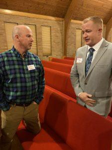Daniel Watson and Adam Brown visit before the forum.