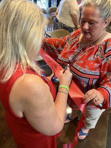 Vice Mayor Wampler signing the cut ribbon