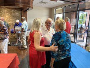 Lenoir City Vice Mayor Jennifer Wampler talking to Jim and Darlene McNeece.