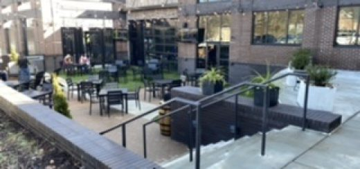 outdoor courtyard, with tv screens and a fireplace