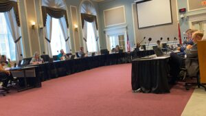 Those gathered around the tables for Policy Review